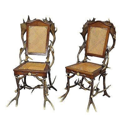 a pair antique rustic black forest cabin chairs ca. 1900