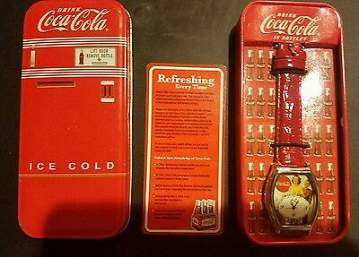 Coca-Cola watch with refrigerator tin .