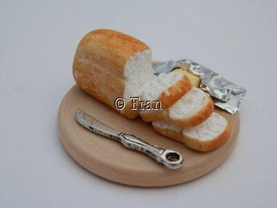 Dolls house food: Sliced bread and butter board -By Fran