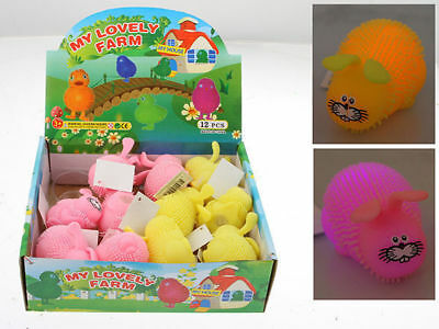 4 squishy easter rabbits flashing in display box 2 colours 5x8cm