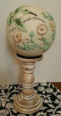 Hummingbird sphere with pedestal made by Carson Home Accents