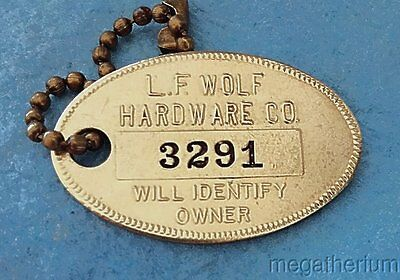 Vintage Brass Charge Coin Tag: LF WOLF HARDWARE (STORE) CO; Mt Clemens MI; Coin