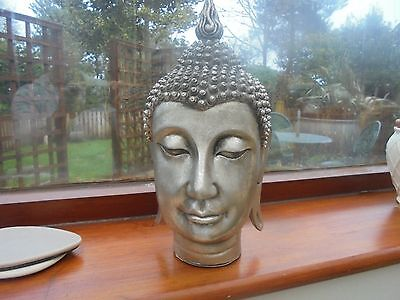 Large silver Buddha head - unwanted gift