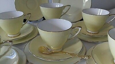 Beautiful Royal Stafford tea set 6 trios in yellow with gold gilding