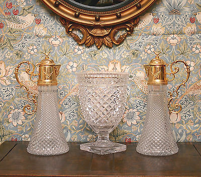 A Fine Large Pair of Empire Style Gilt Brass Wine Carafes with Hobnail Glass