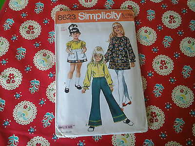 Vintage Simplicity Sewing Pattern For A Childs Dress, Trousers And Skirt