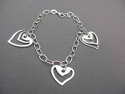 A Sterling Silver heart charm bracelet - nice contemporary style - NEW - 925