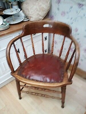 antique captains chair leather seat brown