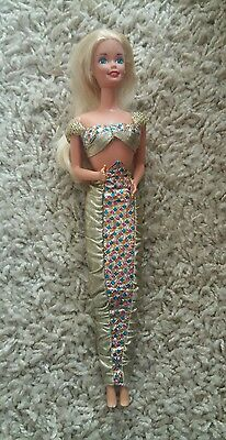 barbie doll with mermaid outfit.