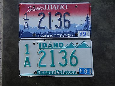 Idaho license plate 2 different color plates same number 1A 2136 stickers 92 &99