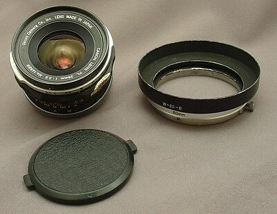 Vintage Canon FL 28mm f3.5 lens - with W-60-B lens hood - great condition
