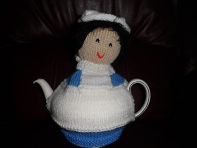 Handknitted nurse tea cosy sky blue and white