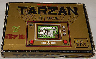 Vintage Tarzan Lcd Electronic Handheld Game & Clock/watch Sun Wing In Box/boxed