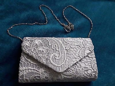 Grey lace clutch handbag with chain handle.  Used once for wedding.