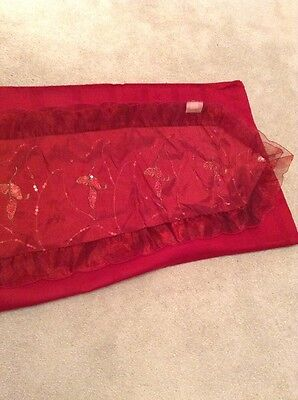 Red Tablecloth And Christmas Runner