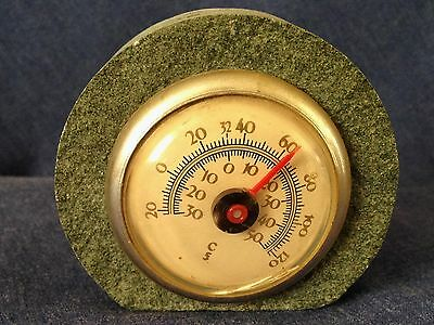 Vintage Thermometer set in stone.