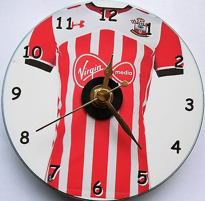 Football cd clock with Southampton shirt on clock face with stand