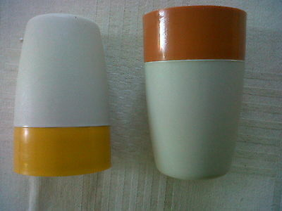 Two vintage Tupperware covered egg cups.