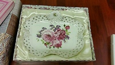 Bone china ornamental plate with flower pattern