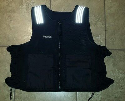 REEBOK 10 pound Weighted Vest (weight not included)