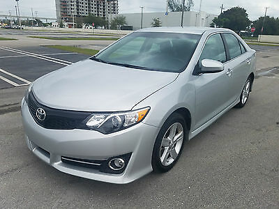 2014 Toyota Camry SE 2014 TOYOTA CAMRY SE MODEL REBUILT TITLE READY TO REGISTER LOW MILES BEST OFFER