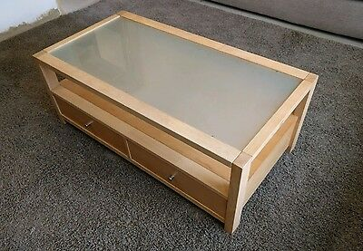 solid wood coffee table with toughend glass top and storage drawers