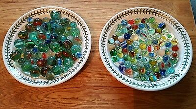 Over 100 marbles varying types and ages