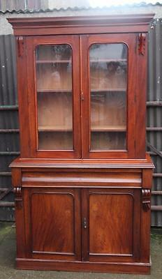 A Large Victorian Carved Mahogany Glazed Bookcase over Cabinet Base