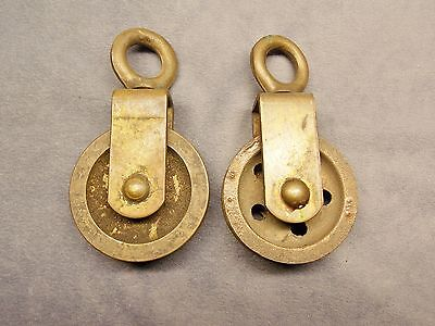 Two marine bronze pulley with swivel eyelet. Crittenden Wilcox and Co.