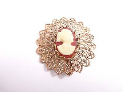 Vintage brooch lace design frame brass red ivory cameo design in the middle