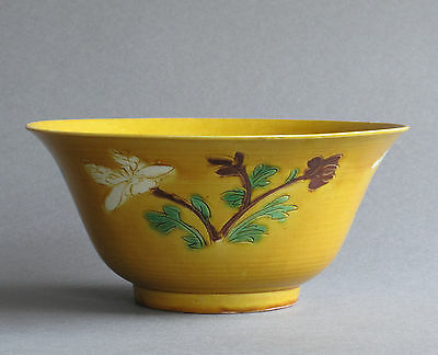 A Chinese biscuit decorated bowl with flowers of the seasons, Kangxi