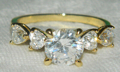 A beautiful sparkling heart cubic zirconia gold plated dress ring size Q