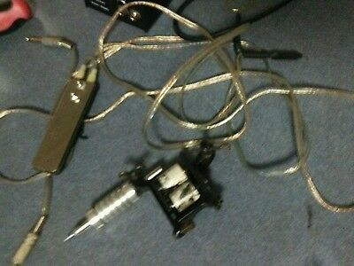 tattoo gun and cords