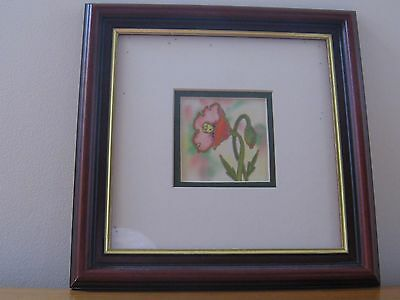 Framed print of a poppy in flower and bud
