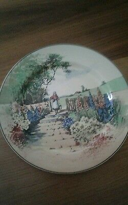 A colourful Royal Doulton plate