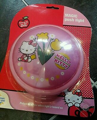 Hello Kitty magic push light changing picture when on. Xmas gift.