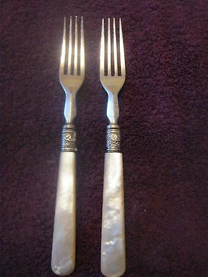 2 silver plate forks with mother of pearl handles