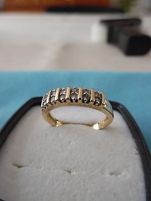 Bague Or 18 K (750/°°°) sertie de 12 diamants