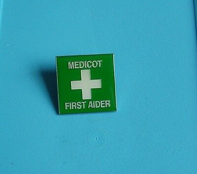 Medicot First Aider stud pin badge charity