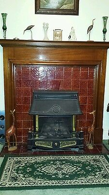 wooden fireplace surround and gas fire