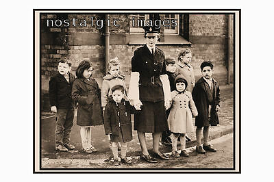PHOTO TAKEN FROM A 1960's IMAGE - FEMALE POLICE OFFICER CROSSING CHILDREN