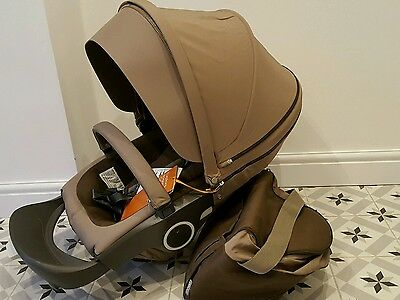 Stokke seat unit- New with tags, incl. shopping bag and accessories, brown