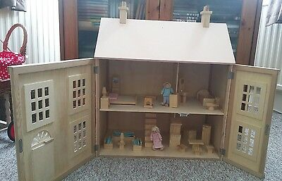 Classic two storey wooden dolls house with all furniture plus people