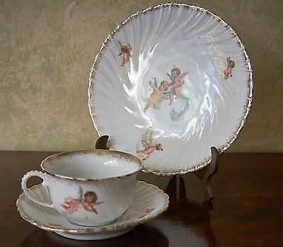 Special porcelain cup, saucer and plate with cherubs and gilt trim