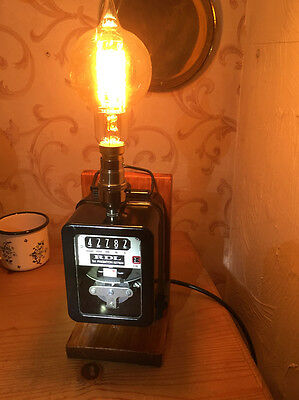 A steampunk lamp on a working electricity meter base.