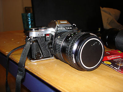 Pentax Program Plus 35MM SLR Camera with two lenses and a case.