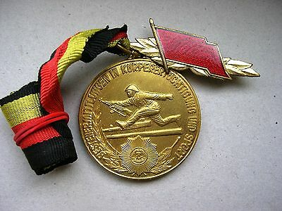 East German DDR Army Sports Gold Medal with this award military uniform badge