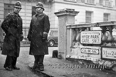 PHOTO TAKEN FROM A 1960's IMAGE OF POLICE OUTSIDE CHURCHILL'S LONDON RESIDENCE