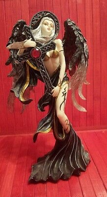 Fairy holding a cross ,10 inches statue .