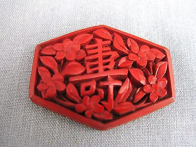 A cinnabar lacqueur plaque for use in jewellery - brooch